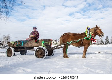 Belarusian traditions, people in carts with horses ride in the winter. Ivye, Belarus January 13, 2018