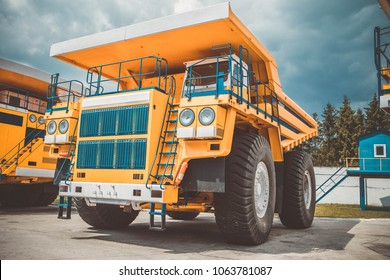 BelAZ  - ultra class haul truck.  Largest haul trucks. The yellow dump truck against the background of thunderclouds