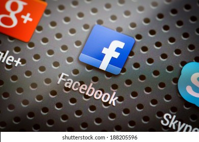BELCHATOW, POLAND - APRIL 10, 2014: Closeup photo of Facebook icon on mobile phone screen. Popular social network.