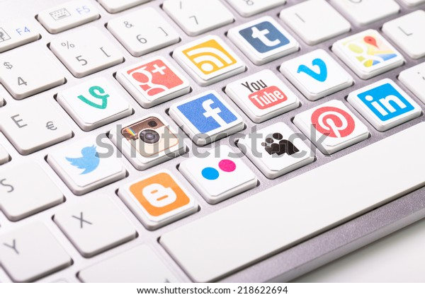 BELCHATOW, POLAND - AUGUST 31, 2014: A social media logotype collection printed and placed on modern computer keyboard.