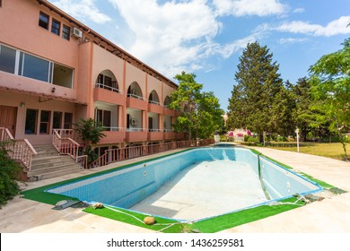 BELDIBI, TURKEY - JUNE 4, 2018: Abandoned hotel building, empty dirty pool.