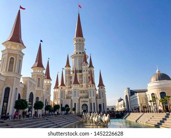 BELEK, ANTALYA, TURKEY - 15 July, 2019: The castle in the Land of Legends theme park and hotel, with white horse statues in front of it.