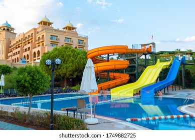 Belek, Antalya / Turkey - August 26, 2109: A colourful waterslide by the pool at Spice Hotel & Spa.