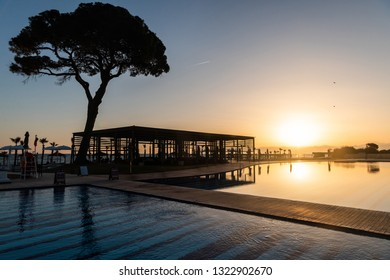 Belek, Antalya, Turkey - February 11, 2019. Swimming pool at Rixos Premium Belek five-star hotel in Belek resort town of Antalya province in Turkey, at sunset.