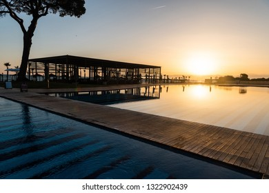 Belek, Antalya, Turkey - February 19, 2019. Swimming pool at Rixos Premium Belek five-star hotel in Belek resort town of Antalya province in Turkey, at sunset.
