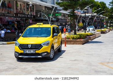 Belek, Antalya / Turkey-06.23.2018: Turkish taxi stands on the square in the commercial town of Belek. Summer, hot, noon.