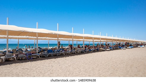 Belek,  Turkey - Aug. 08, 2019: Vacationers on the beach near the sea. Vacation and happy life style concept. Summer holidays background