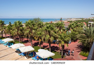 Belek,  Turkey - Aug. 08, 2019: Relaxation area in a beach resort. Vacation and happy life style concept. Summer holidays background