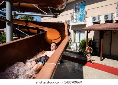 Belek,  Turkey - Aug. 08, 2019: Water rides in the relaxation area at the seaside resort. Vacation and happy life style concept. Summer holidays background