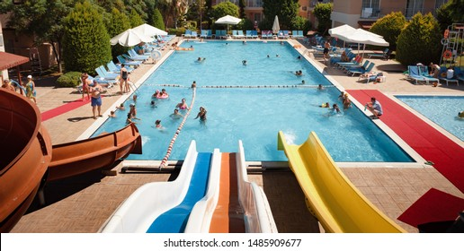 Belek,  Turkey - Aug. 08, 2019: Swimming pool in a relaxation area in a beach resort. Vacation and happy life style concept. Summer holidays background