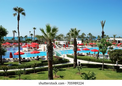 Belek, Turkey - June 01, 2015: View of  blue pool and bar under big white umbrella in hotel Kaya Palazzo Golf Resort, Turkey.