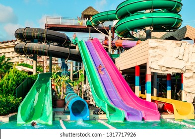 Belek, Turkey - September 11, 2018. The girl is going down from the waterslide in aquapark at the Papillon Belvil hotel. The concept of summer holidays, sports, tourism