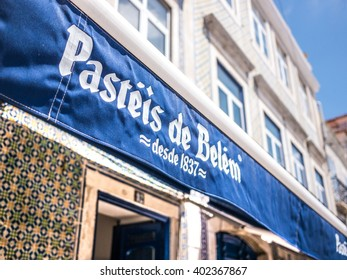 Belem, Portugal - April 28, 2014: The main entrance of the Pasteis de Belem (Pastries of Belem) store. The pastries of this shop are well known around the world and a touristic destination.