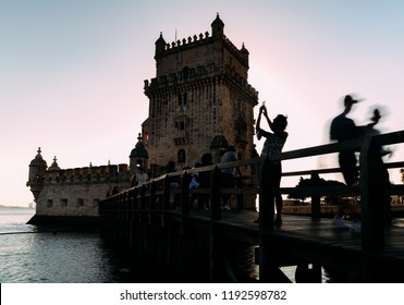 Belem, Portugal - Sept 23, 2018: Long exposure backlit tourists at Belem Tower, or the Tower of St Vincent, a fortified 17th-century tower in Belem, Lisbon, Portugal