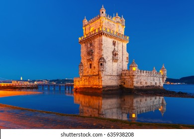 Belem Tower or Tower of St Vincent on the bank of the Tagus River during evening blue hour, Lisbon, Portugal