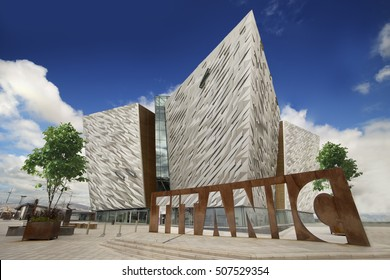 Belfast, Antrim County, Northern IRELAND - AUG 2, 2016: Titanic Belfast, Museum and Visitors Center on the place where Titanic was built with Titanic Sign in front of the building.