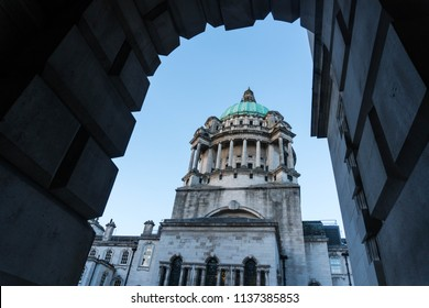 Belfast City Hall through stone archway