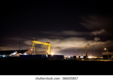 Belfast, County Antrim, Northern Ireland - February 23, 2017: View over Belfast's iconic docklands at night, including Harland and Wolff's Samson and Goliath Cranes.