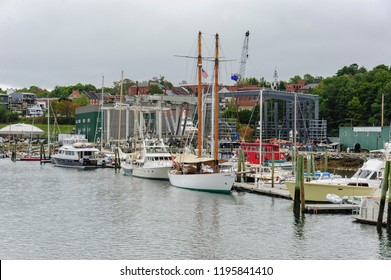 Belfast, Maine, USA - September 19, 2018: Yachts docked along Belfast, Maine waterfront on overcast late summer day