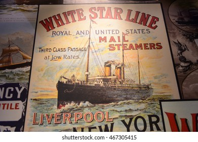 BELFAST, NI - JULY 14, 2016: White Star Line antique posters in the Titanic Belfast, visitor attraction dedicated to the RMS Tinanic, a ship whic sank by hitting an iceberg in 1912.