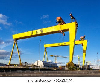 BELFAST, NORTHER IRELAND, UK - OCTOBER 2, 2016: Samson and Goliath. Twin shipbuilding gantry cranes in Titanic quarter, famous landmark of Belfast, Norther Ireland. Goliath is in the foreground.