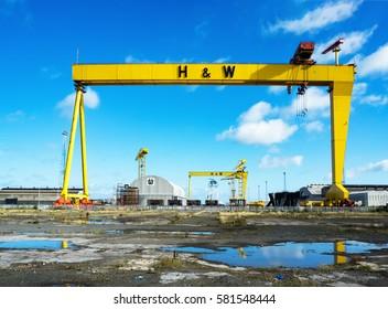 BELFAST, NORTHER IRELAND, UK - SEPTEMBER 25, 2016: Samson and Goliath. Twin shipbuilding gantry cranes in Titanic quarter, famous landmark of Belfast, Norther Ireland. Goliath is in the foreground.