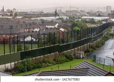 BELFAST, NORTHERN IRELAND  - AUGUST 1: Wall dividing Catholic Belfast from Protestant neighborhood. August 1, 2018 in Belfast, Northern Ireland.