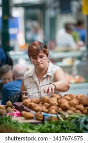 BELFAST, NORTHERN IRELAND  - AUGUST 3: Unidentified woman selects produce in Saint George's Market.. August 3, 2018 in Belfast, Northern Ireland.
