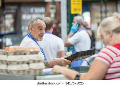 BELFAST, NORTHERN IRELAND  - AUGUST 3: Unidentified man selling eggs in Saint George's Market. August 3, 2018 in Belfast, Northern Ireland.