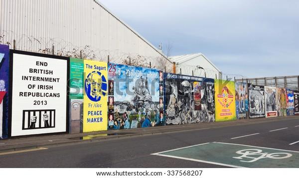 BELFAST, NORTHERN IRELAND - FEB 9, 2014: Political mural in Belfast, Northern Ireland. Falls Road is famous for its political murals.