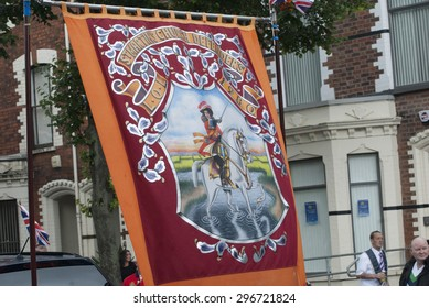 BELFAST, NORTHERN IRELAND - JULY 2014: Loyalist banners march though the streets of Belfast during the annual Twelfth of July events.