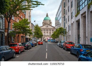Belfast, Northern Ireland - Jun 18, 2018: City street leading to a city hall