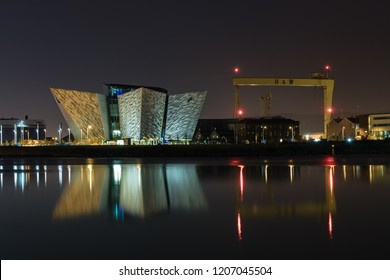 Belfast, Northern Ireland- June 13, 2017 : The Titanic building and H&W cranes reflecting in the River Lagan.