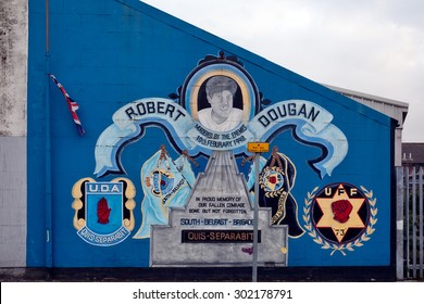 Belfast, Northern Ireland - September 18, 2014 : loyalist paramilitary mural painter on a wall in south Belfast .