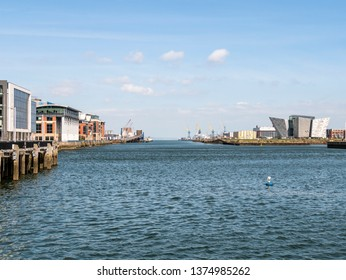 Belfast, Northern Ireland, UK - April 13 2019: River Lagan with Clarendon Dock to the left and Titanic Belfast to the right