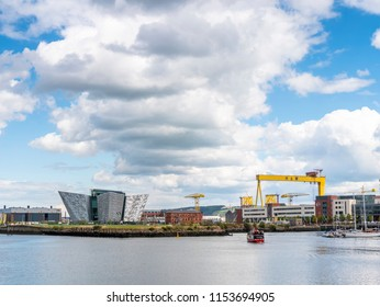 Belfast, Northern Ireland, UK - August, 8, 2018: Titanic Quarter, Belfast showing Titanic Belfast, Harland and Wolff crane and Drawing Office, now the Titanic Hotel.