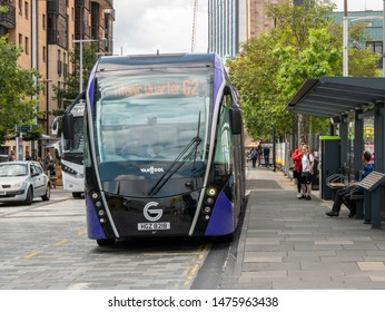 Belfast, Northern Ireland, UK - August 7, 2019: A Glider bus in stopped to pick up passengers in Queen's Square