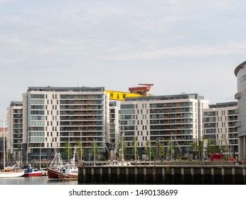 Belfast, Northern Ireland, UK - August 24, 2019: One of the Giant Harland and Wolff Shipyard cranes is visible behind apartment blocks, Titanic Quarter