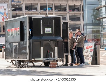 Belfast, Northern Ireland, UK - May 14, 2019: People queuing at a fast food truck, Donegall Quay