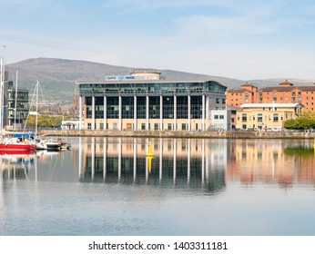 Belfast, Northern Ireland, UK - May 14, 2019: Beacon House, Clarendon Road with reflection in the River Lagan