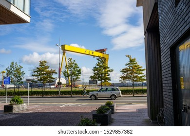 Belfast, Northern Ireland, UK - October 12, 2019: A Harland and Wolff Shipyard crane viewed through buildings in Titanic Quarter