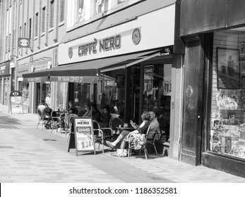 BELFAST, UK - CIRCA JUNE 2018: Caffe Nero Italian coffee bar in black and white