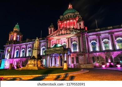 Belfast, UK. Nightlife with illuminated city hall in Belfast, UK the capital of Northern Ireland at night with dark sky