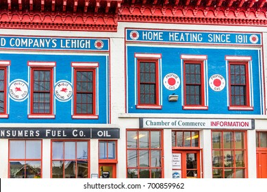 Belfast, USA - June 9, 2017: Empty small village in Maine during rain with Home Heating sign and Chamber of Commerce
