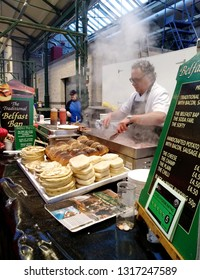 Belfast/Northern Ireland - December 30,2017 : The owner of Belfast Bap Co, cooking his traditional signature Belfast Baps in St.George Market food stall.