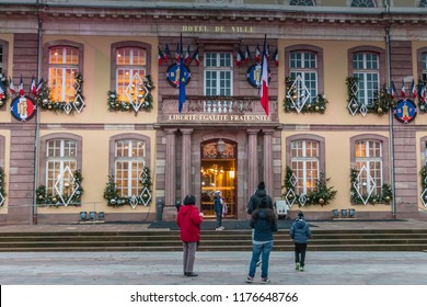Belfort, France, December 26, 2016: The town hall and the Place d'Armes in Belfort in Franche-Comte that tourists visit on the evening of a winter day