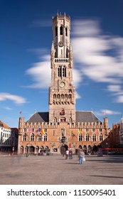The Belfry (Belfried) tower at the market place in Bruges, Belgium with blue sky. Long exposure shot.