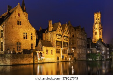 Belfry of Bruges reflected in the canal. Bruges, Flemish Region, Belgium