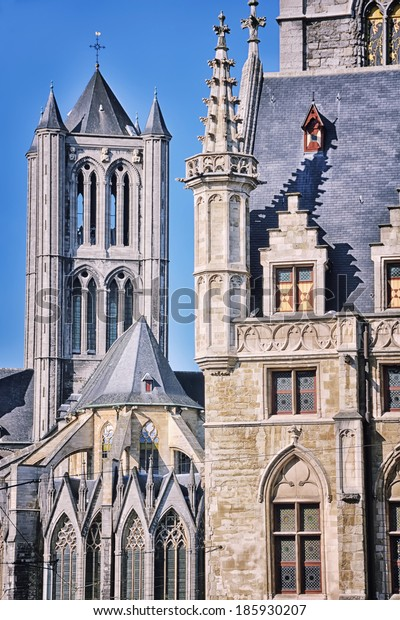 Belfry of Ghent and Sant - Nicholas Church. Close view of medieval architecture in popular flemish city in Belgium