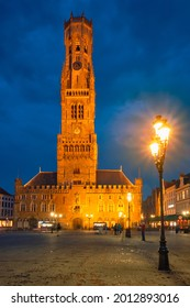 Belfry tower famous tourist destination and Grote markt square in Bruges, Belgium on dusk in twilight